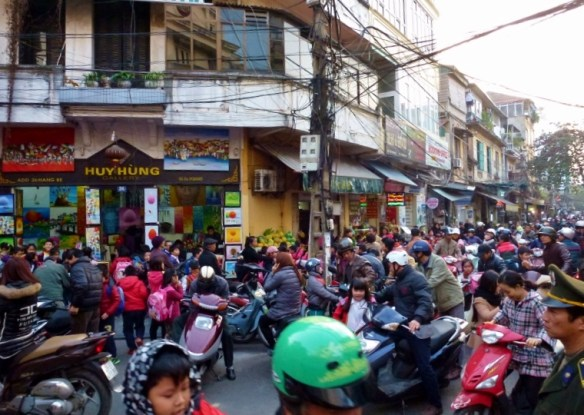Hanoi Vietnam traffic in old quarter. It can be a bit overwhelming when crossing the street in Vietnam for the first time.  We learned how to cross the street in Vietnam like the locals. It is a great feeling to accomplish such a task and we share our tips with you and a video too! Read more on WagonersAbroad.com