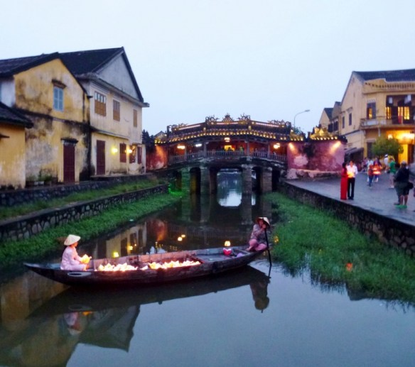Hoi An Vietnam at dusk with Japanese Bridge in the background
