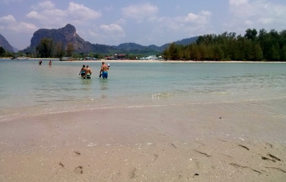 Ao Nang Beach at the end with island = There's no shortage of fun things to do in Krabi Thailand & Ao Nang Beach. This adventure consists of water and wheels. What more could you ask for? Read more on WagonersAbroad.com