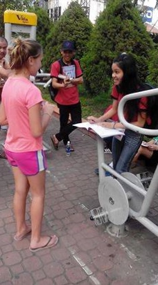 Students in Ho Chi Minh City Vietnam park speaking English