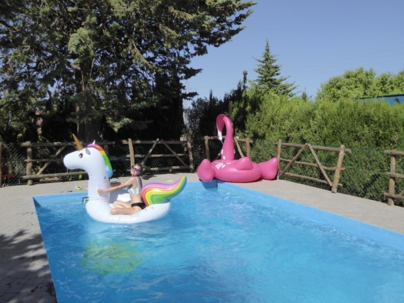 Glamping in Spain at the Nomad Xperience. Anya was having a blast on the unicorn in the pool.