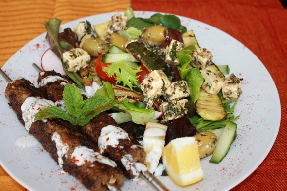 Skewers of meat are Souvlaki plural souvlakia, is a popular Greek fast food consisting of small pieces of meat and sometimes vegetables grilled on a skewer.