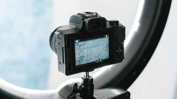 contemporary professional photo camera prepared for shooting