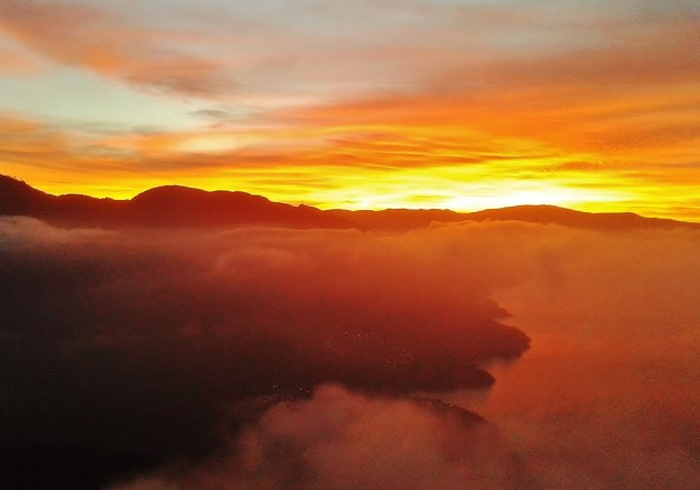 watching a sunrise from top of a volcano