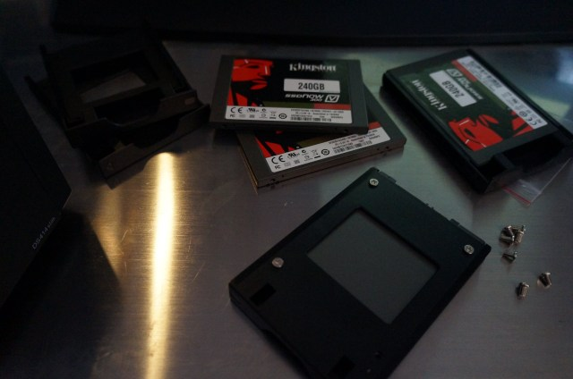 Screwing in four SSDs into the drive mounts