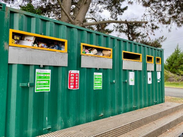 Overflowing recycling station.