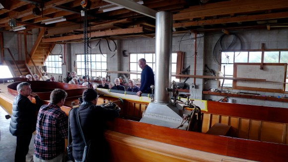 Chris McMullen & his 1898 reproduction Herrreshoff steam boat