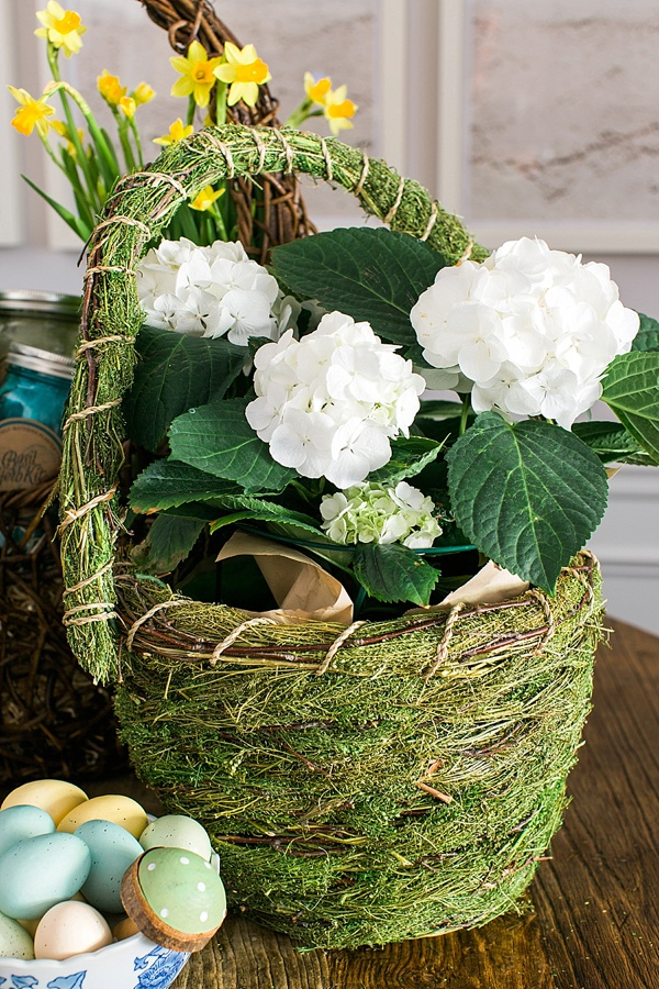 Moss covered Easter basket with flowers via Waiting on Martha