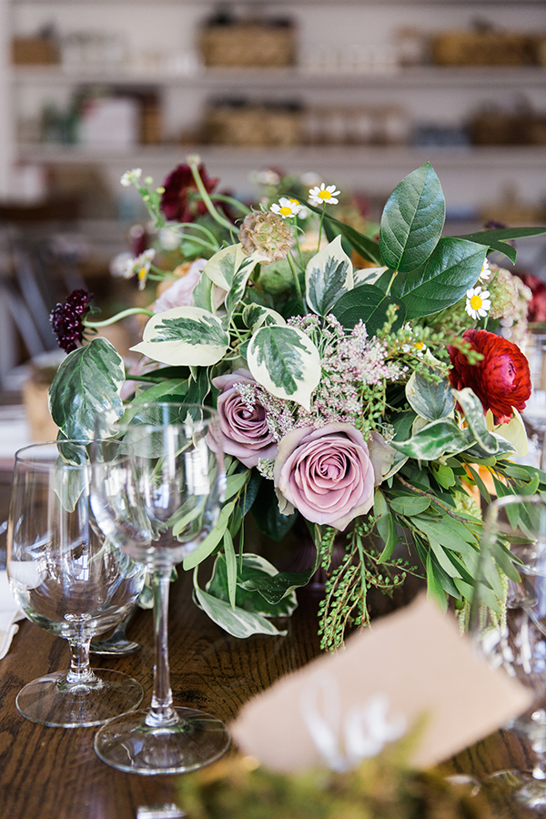 Lush floral centerpiece and rustic tablescape