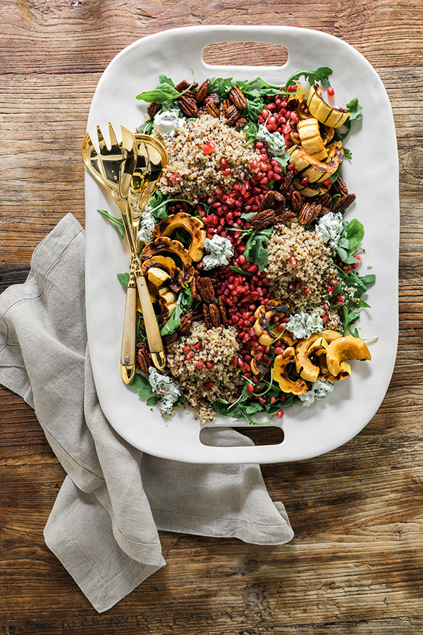 Delicata squash salad with rainbow quinoa, pomegranate seeds, candied pecans and herbed goat cheese. Recipe by @waitingonmartha