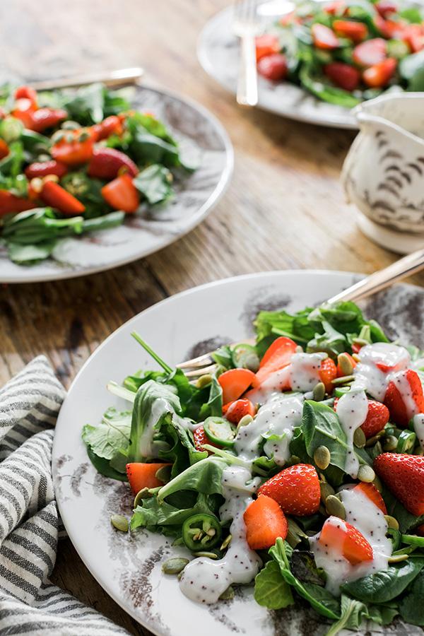 Baby kale salad with strawberries, pumpkin seeds & more via waitingonmartha.com