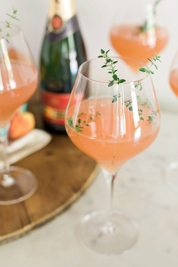 Peach Bellini with thyme garnish recipe on Waiting on Martha