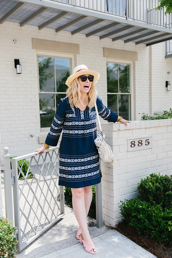 Embroidered dress with panama hat and Sigerson Morrison slides on Waiting on Martha