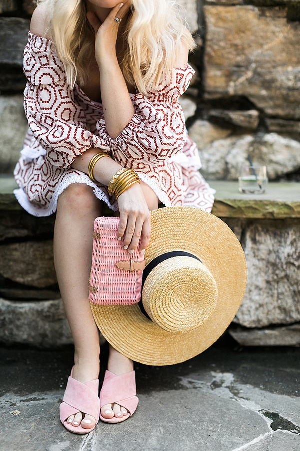 A red white Alexis dress with pink accessories