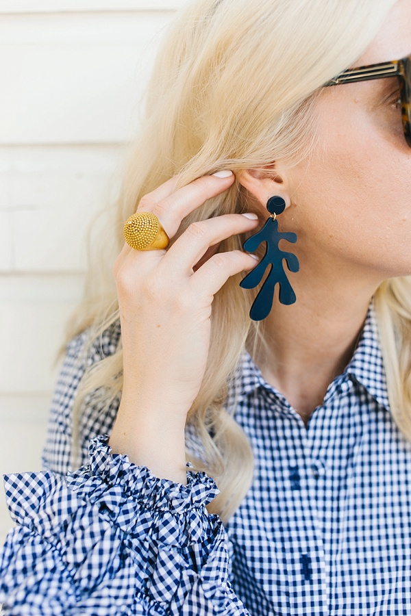 Navy blue statement earrings with gold cocktail ring, Waiting on Martha