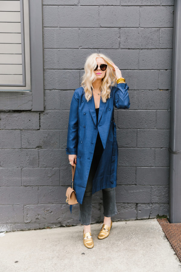 Blue silk trench coat with black bodysuit, grey jeans and gold flats