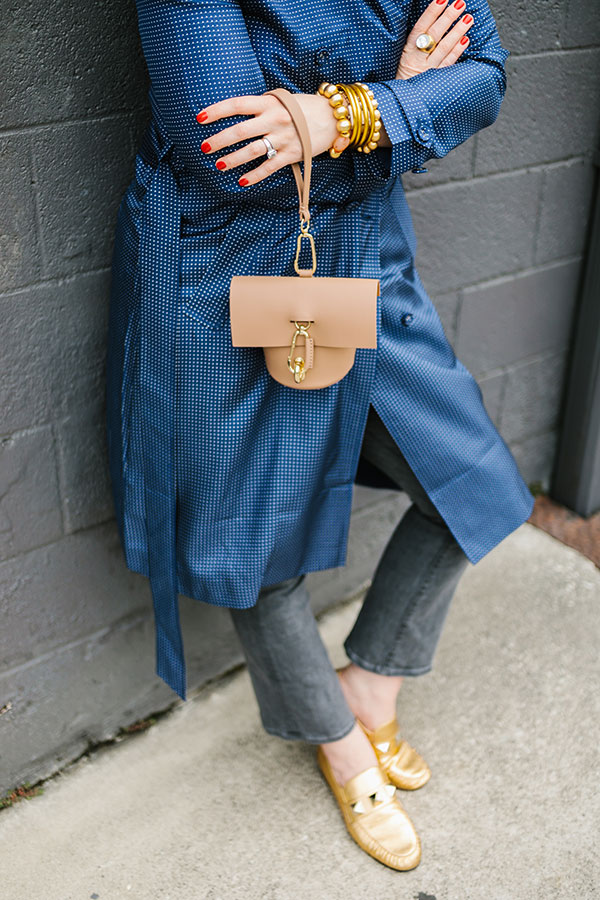 Silk trench dress outfit with wristlet and gold shoes