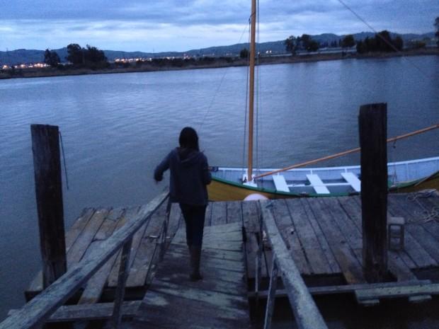Rachel walks down the dock