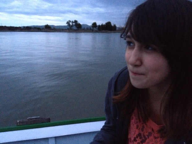 Sitting at dusk in a little boat