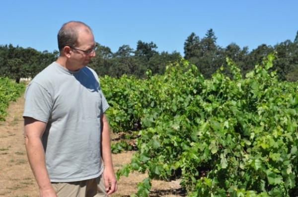 Mike Officer next to old vine Zinfandel