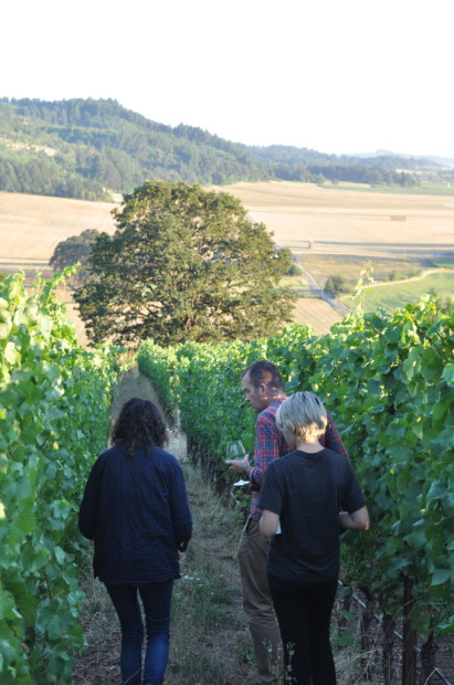 Maggie Harrison, Jamie Goode, and Rachel walking the slopes of Antica Terra