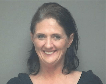 Happiest Mugshot Ever! Busted For Handing Out weed-infused cookies and gummy candies' at a Wisconsin St. Patrick's Day parade !