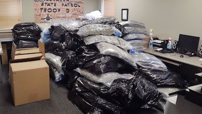 Troopers find nearly 2,300 lbs of marijuana during motorist assist!