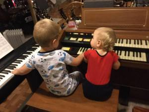 Kids playing on organ