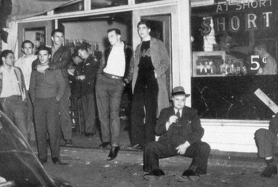 Sidewalk outside of Shorty's, 1943.
