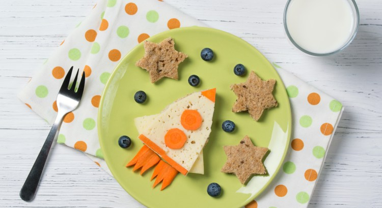 Funny sandwich with rocket and stars, meal for kids idea, wooden table
