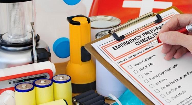 Ready for disaster - checking off the items on the emergency  preparedness form