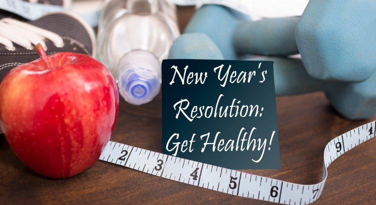 "New Year's Resolution to get healthy in January of the coming year.  Image features: dumbbells, sports shoes, water bottle, apple, towel, tape measure on wooden table.  Adhesive note reading ""New Year's Resolution: Get Healthy!"" in foreground.  Fitness concept."