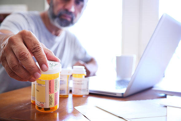 man-taking-medications-GettyImages-864430134
