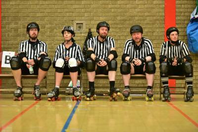 Refs sitting in the penalty box during half time