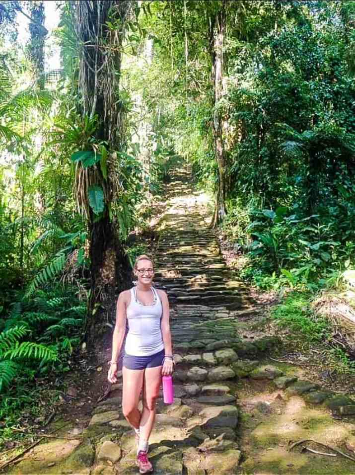 climbing the stairs into the lost city on a lost city tour colombia