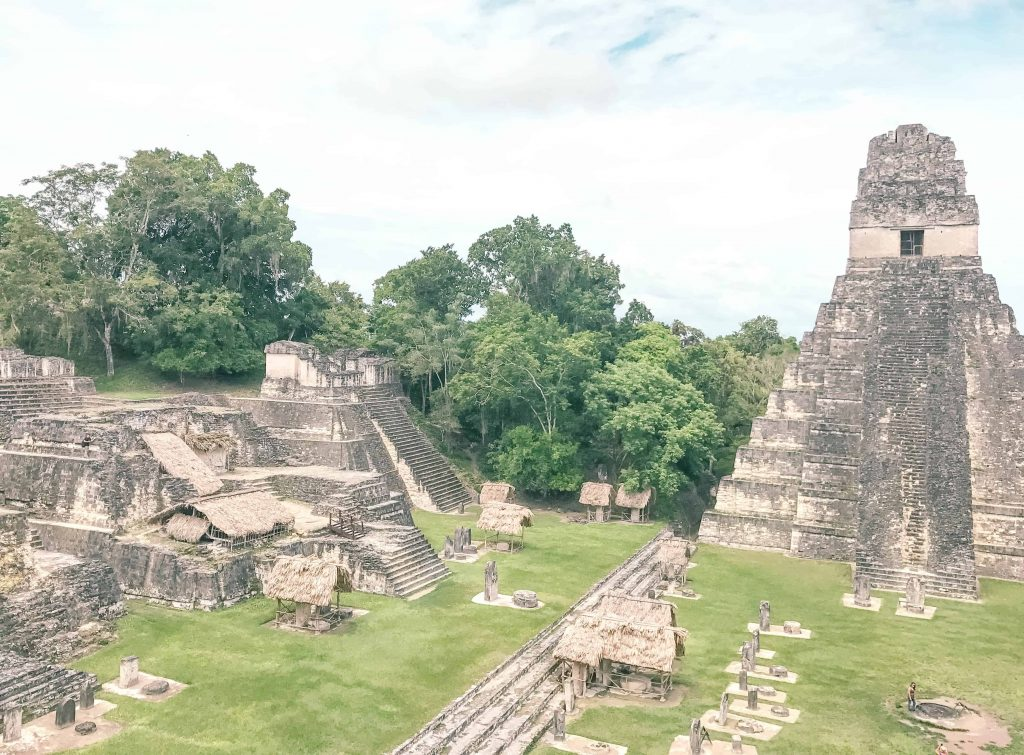 a view of the main plaza in tikal