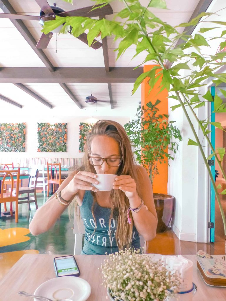 drinking coffee in flores guatemala