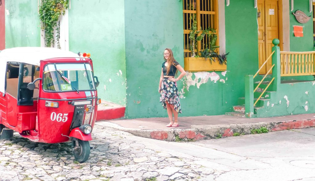 waiting for a tuk tuk in flores guatemala