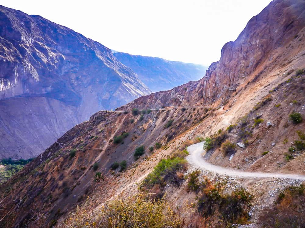 hiking down colca canyon in peru
