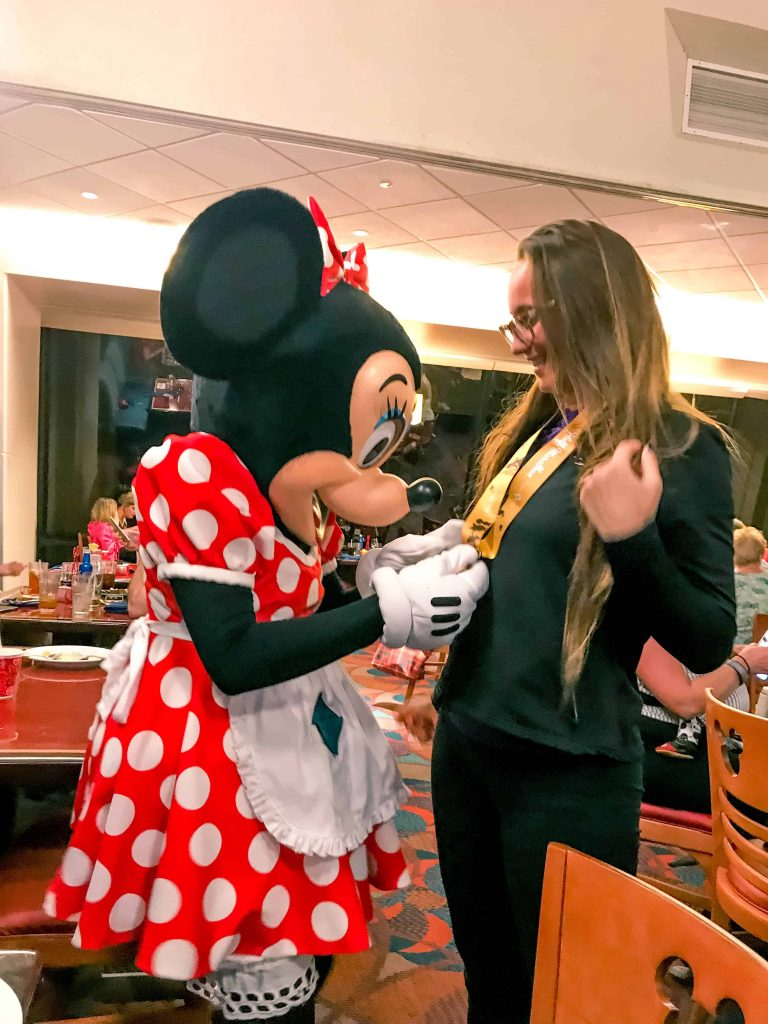 meeting minnie at chef mickeys dinner at the contemporary resort