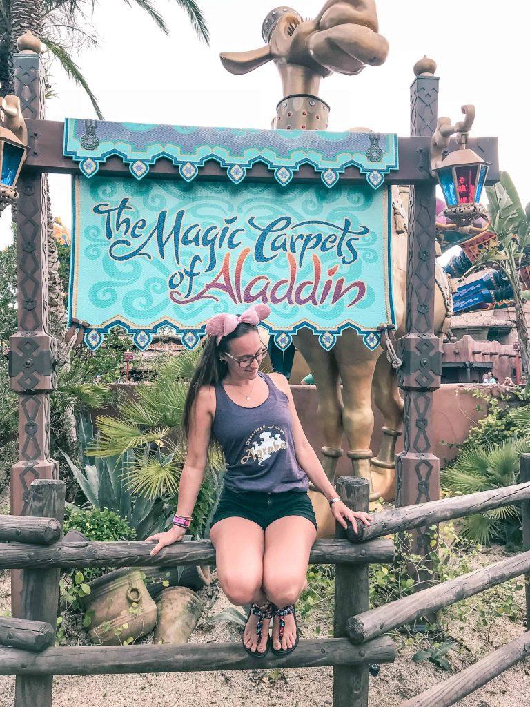 waiting to ride the magic carpets of Aladdin at Disney World