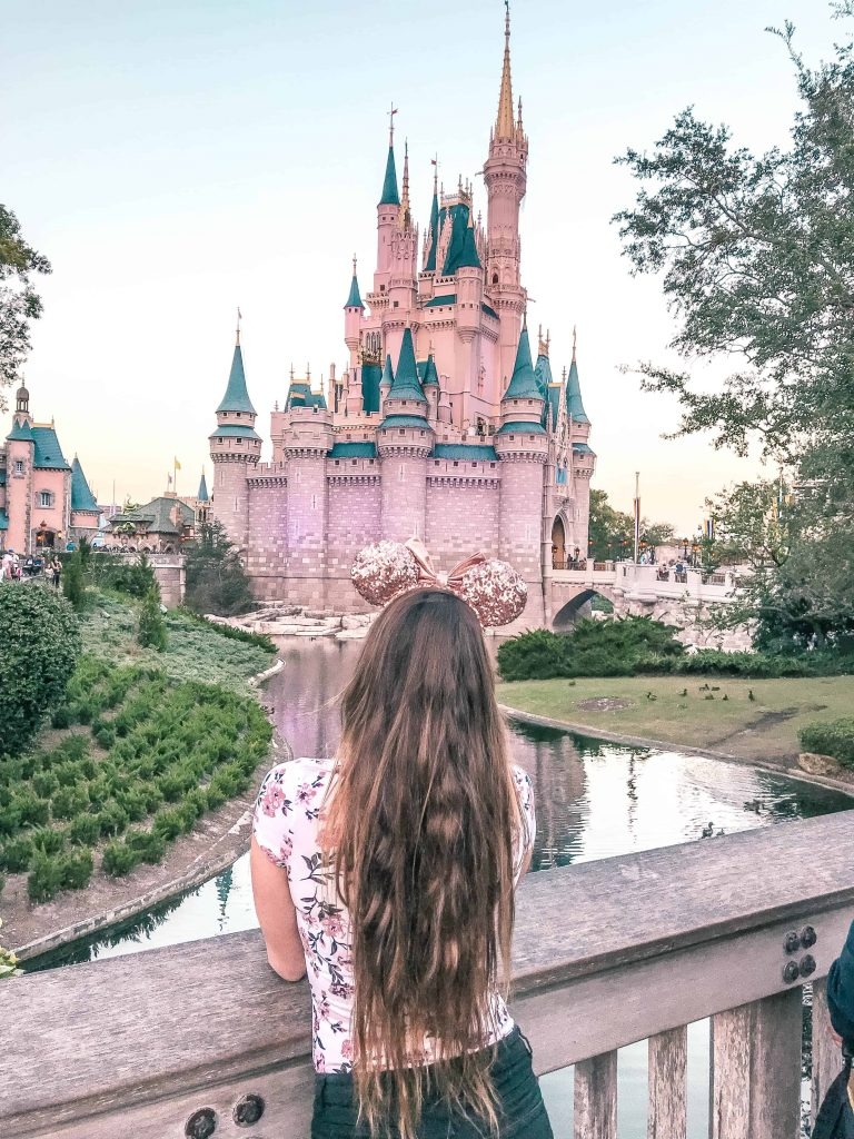 enjoying the view of cinderella castle in magic kingdom at disney world