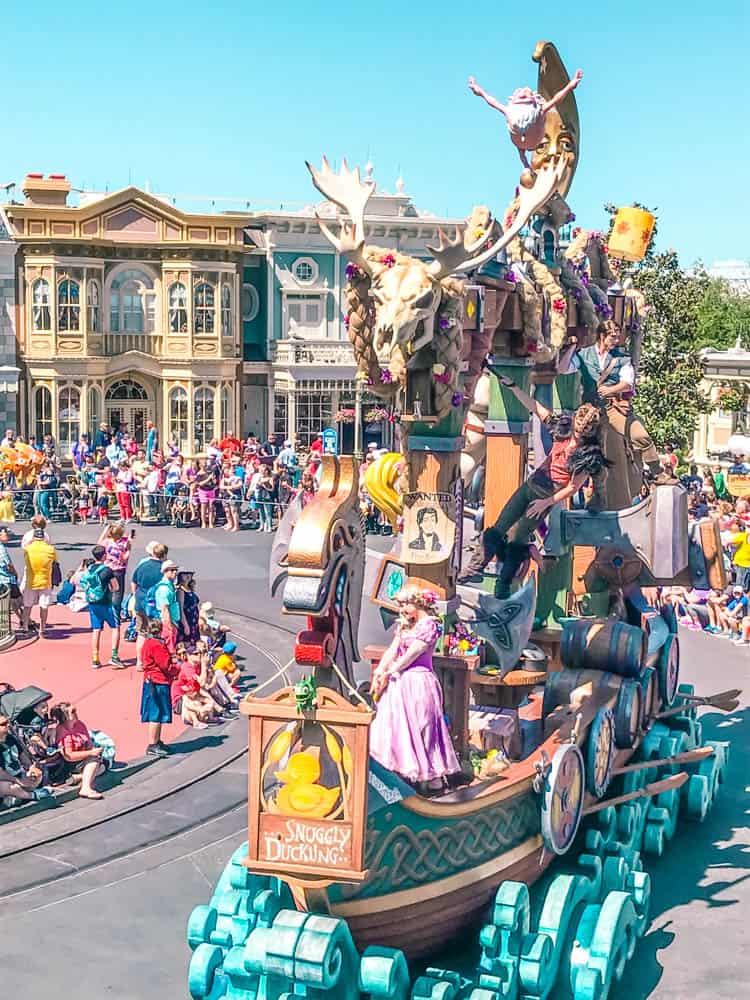 watching the festival of fantasy parade in magic kingdom at walt disney world