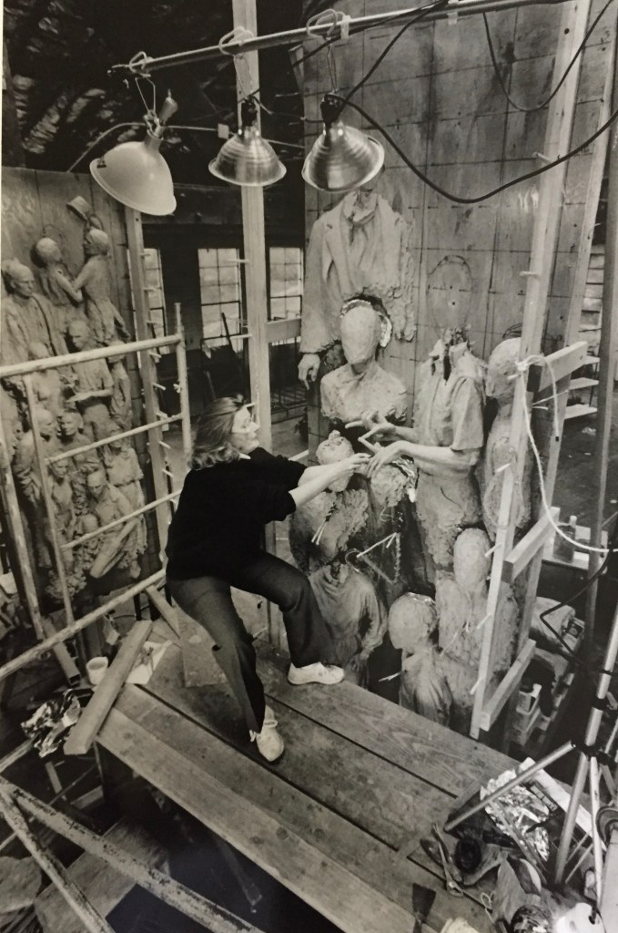 Marion Young working on Street Scene, at her studio in the Oregon Shakespeare Festival scene shop.
