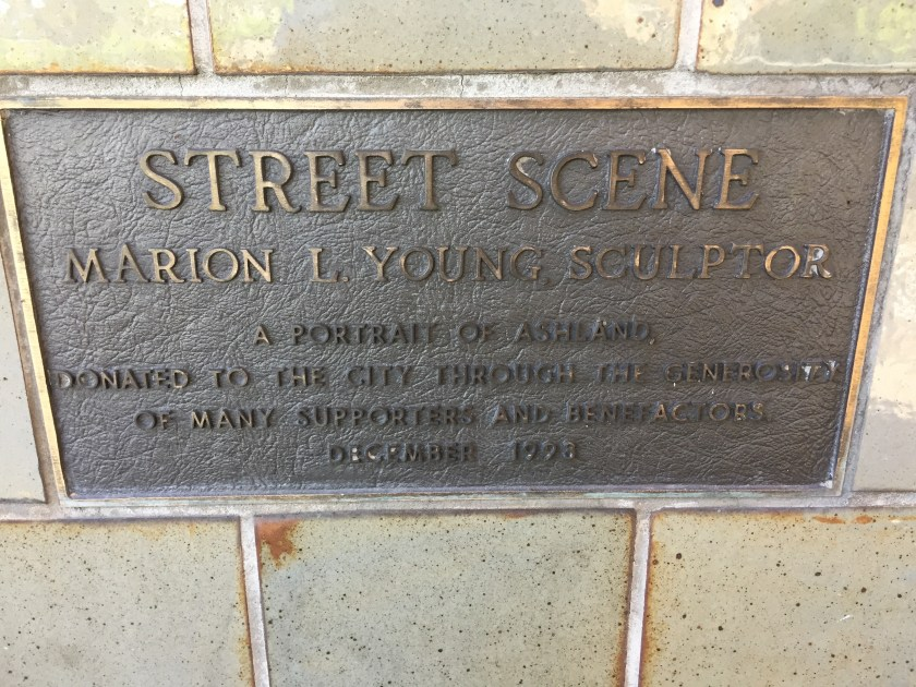 Label at bottom of Street Scene sculpture.