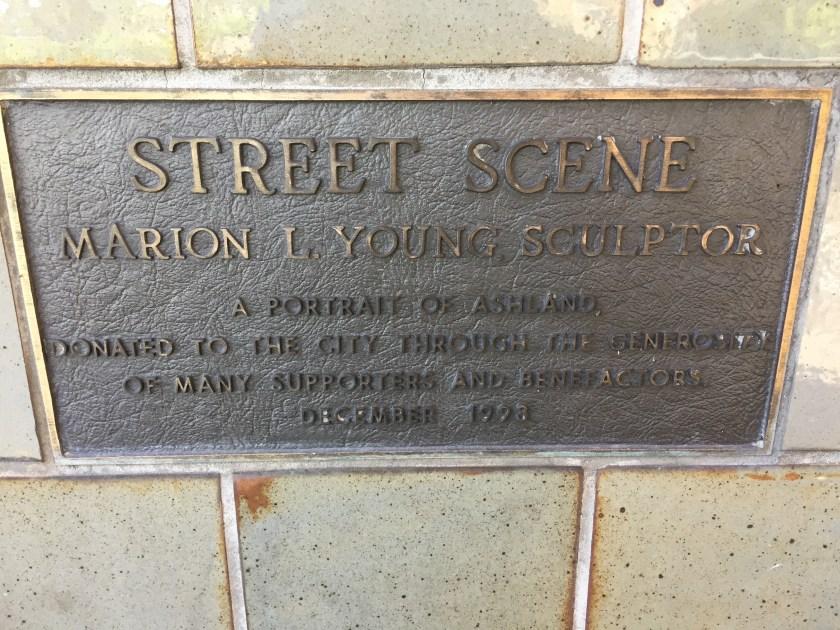 Label at bottom of Street Scene sculpture.