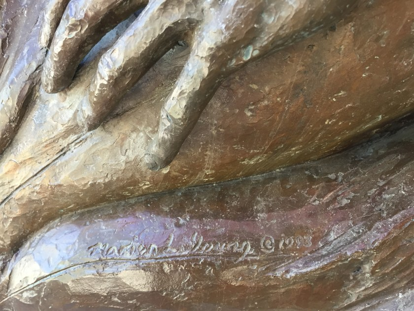 Marion Young's signature on Street Scene sculpture