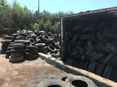 Tires are loaded onto trailers and hauled to a recycling center