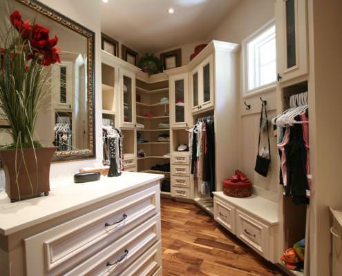 custom closets,white cabinets,shoe rack,dressing room,jewelry drawer
