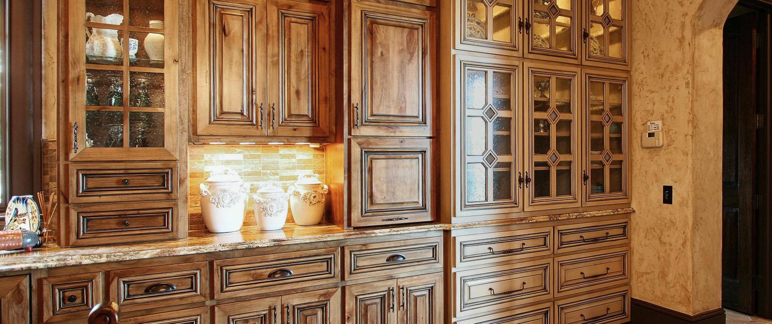 maple stained cabinets,painted hutch,glass front cabinets,french country